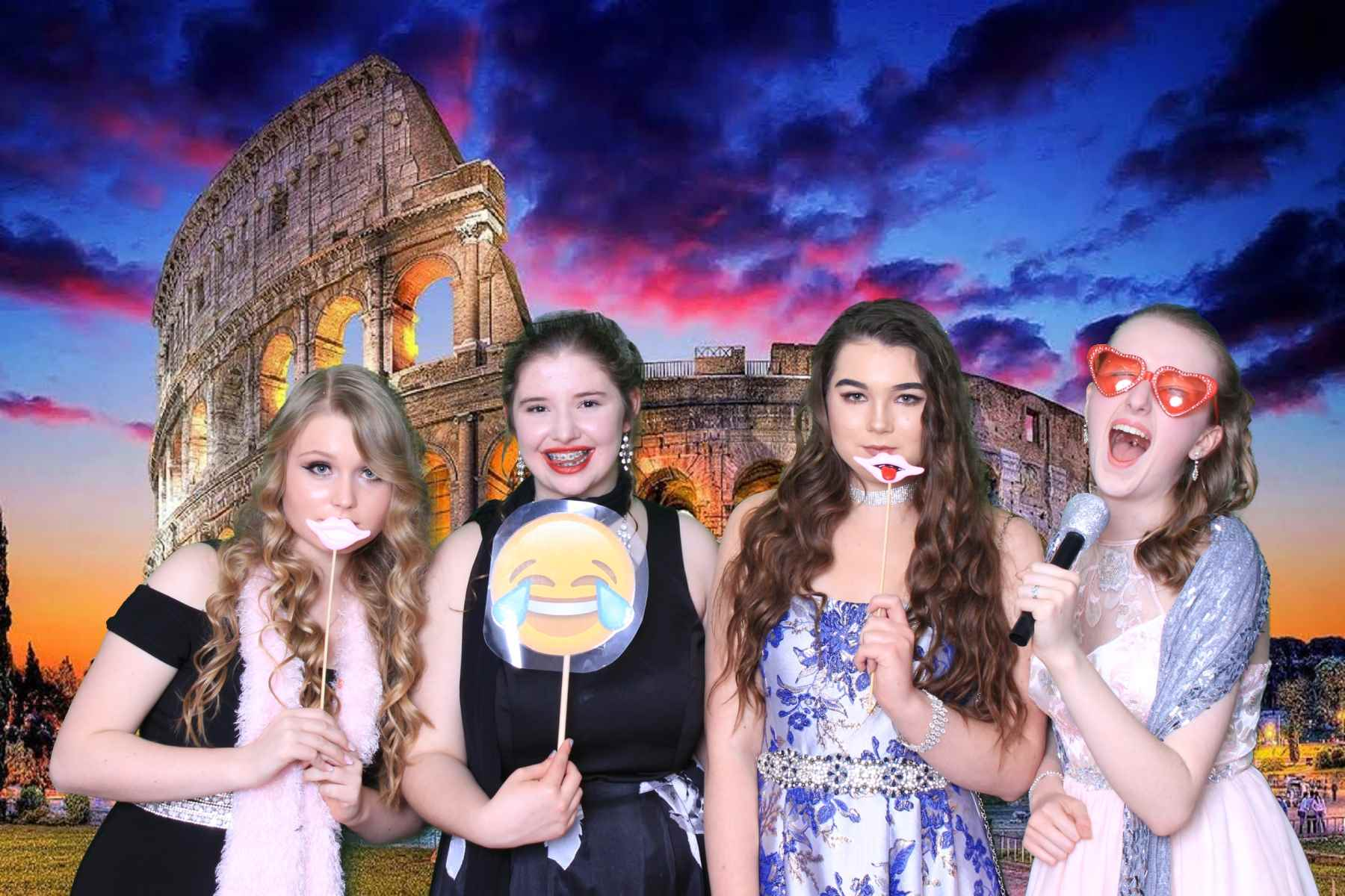 4 girls having a great time at prom with props